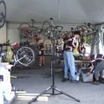 Mechanics preparing bikes for the riders