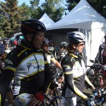 Phil Liggett, pro cycling Tour de France commentator, talks with riders before setting out for the 100km ride