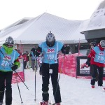 Race participants jump on their skis